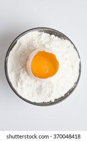 an egg in flour