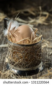 Egg. Fresh farm eggs. Easter egg with feather concept.