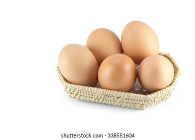 egg fresh on weave basket in white isolate background