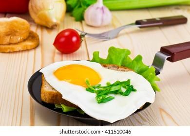 Egg Fried Bread with Lettuce, Sandwich for Breakfast Studio Photo