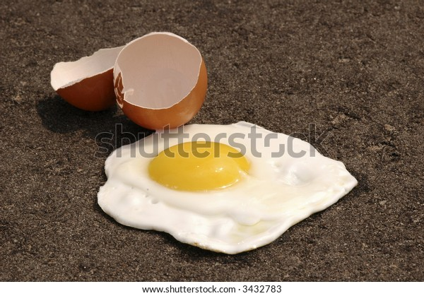 Egg frying on asphalt on a hot summer day.