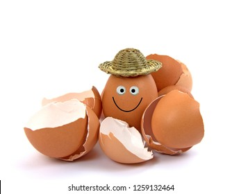 Egg with hat and funny face and eggshells
