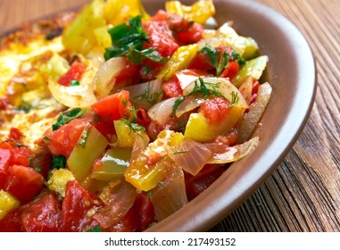 Egg in a hole is breakfast menu  with tomato and capsicum