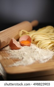 Egg and homemade noodles on wooden table