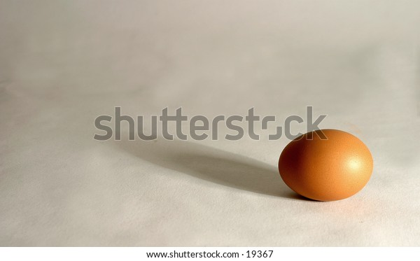 an egg with long shaddow