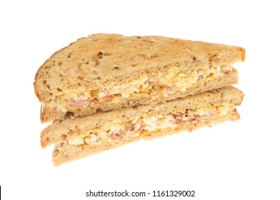 Egg mayonnaise and bacon sandwiches made with lightly toasted granary bread, isolated against white