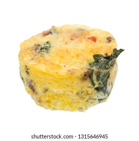 Egg muffin with spinach, bacon, cheese and tomatoes isolated on white