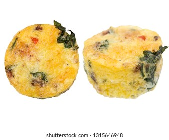 Egg muffins with spinach, bacon, cheese and tomatoes isolated on white