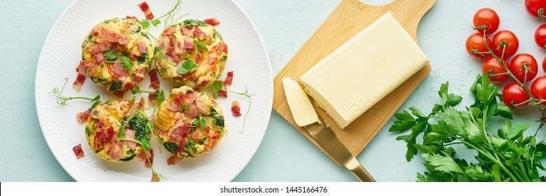 egg muffins with spinach, bacon and tomato, ketogenic keto diet low carb, pastel and modern background top view banner long