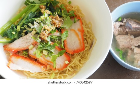 Egg noodle Cantonese recipes with BBQ pork and pork bone soup in set, Photo close up full frame look testy.