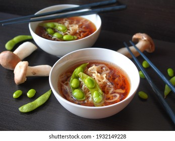 Egg noodle or ramen with soysauce soup topping with green bean, Japanese food.