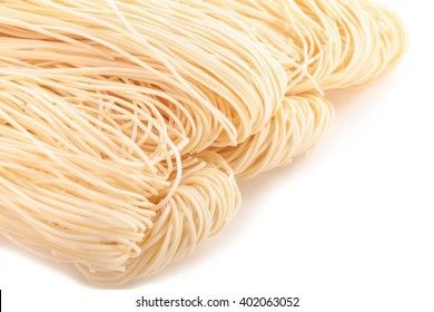 Egg noodles on a white background.