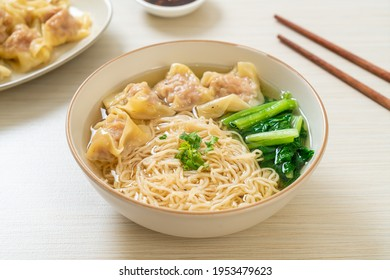 egg noodles with pork wonton soup or pork dumplings soup and vegetable - Asian food style