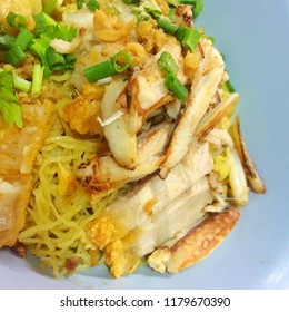 Egg noodles serve dry with crispy pork belly, crab and shrimp's wonton, chinese food