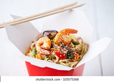 Egg noodles with shiitake mushrooms, shrimp and pork in sweet and sour sauce
