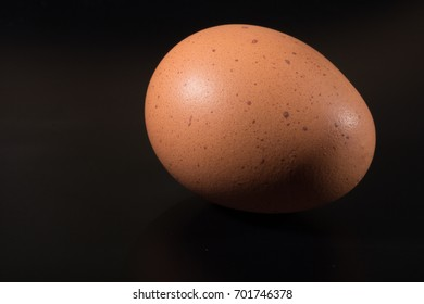 egg on black surface