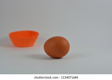 An egg with an orange muffin  form