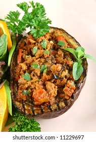 Egg plant stuffed with bolognaise with side salad and garnish.