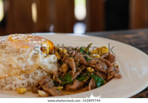 Egg and rice with sweet basil leaves. Its Krapow Moo in thai food menu