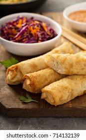 Egg rolls with cabbage and chicken on a wooden board