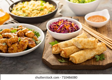 Egg rolls with cabbage, chicken, rice and cole slaw, asian food concept