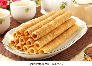Egg rolls on white plate