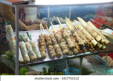 Egg rolls, skewer kabobs and other street food at the Ben Thanh market, Saigon (Ho Chi Minh City),  Vietnam