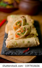 Egg rolls or spring rolls fried.Traditional Chinese Thai restaurant appetizer, spring rolls or egg rolls. Made from wonton wrappers, filled with Chinese veggies and served with chili dipping sauce.