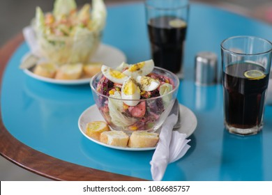 Egg salad in a bowl on a table.