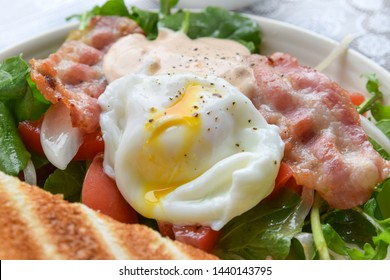 egg with salad and slices of toast for breakfast