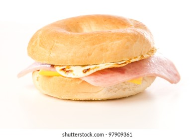 Egg Sandwich / This is a photo of a delicious egg ham and cheese sandwich on a toasted bagel. Shot on a white background.