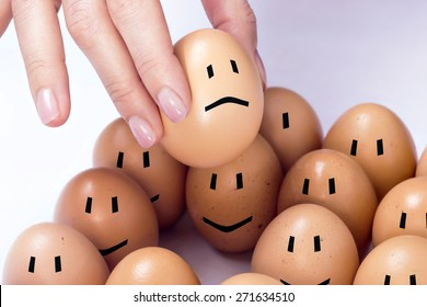 An egg selected among the others, feeling sad