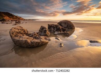 Egg shape boulders in Moeraki Boulder beach, Otago, New Zealand