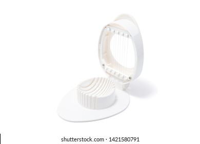 Egg slice or Egg cutter for cutting boiled eggs isolated on white background. Selective focus.