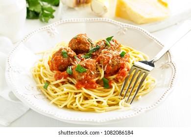 Egg tagliatelle with meatballs in tomato sauce.