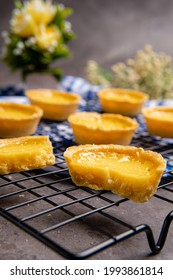 The egg tart  is a kind of custard tart found in Cantonese cuisine derived from the English custard tart and Portuguese pastel de nata. Egg tarts are often served at dim sum restaurants and cha chaan