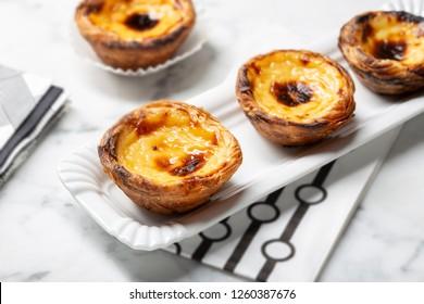Egg tart on tray, traditional portuguese dessert, pastel de nata, custard tarts