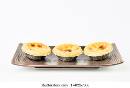 Egg tart, traditional Portuguese dessert on dish isolated with  white background