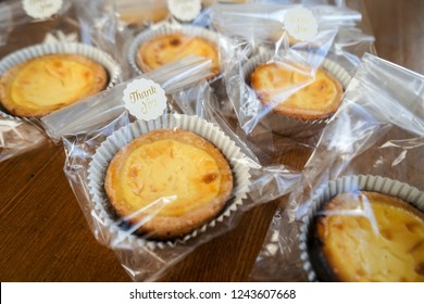 Egg tarts packaged in small clear bags and thank you stickers.
