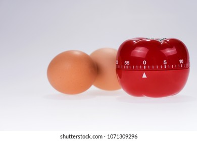 Egg timer mockup in the form of a tomato with two eggs