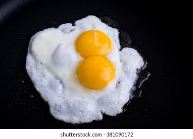 Egg with two yolks in pan