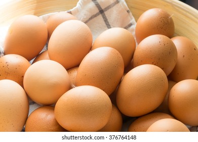 egg in wooden basket with cloth.