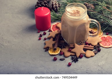 Eggnog with cinnamon .Christmas and winter holidays. Homemade eggnog in glasses with spicy rim. concrete background