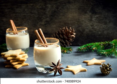 Eggnog with cinnamon and nutmeg for Christmas and winter holidays. Homemade eggnog in glass with spicy rim.