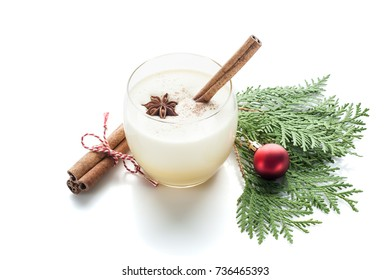 eggnog cocktail in a glass arranged with christmas decoration isolated on white background