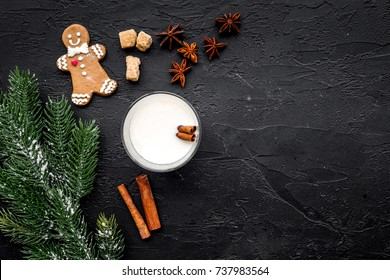 Eggnog, gingerbread cookie with cinnamon and spruce for new year 2018 celebraton winter set. Black background top view space for text