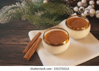 eggnog in glasses on the background of fir branches, Christmas atmosphere
