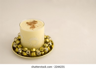 Eggnog surrounded by bells, with room for copy