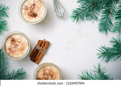Eggnog, Traditional Christmas Drink, Homemade Cocktail with Cinnamon and Nutmeg for Winter Holidays, Top View