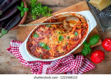 Eggplant aubergine bake with tomato sauce, mozzarella and parmesan cheese, healthy vegetarian dish parmigiana